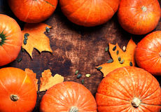 Autumn wood background with pumpkins over wooden table with Royalty Free Stock Photography