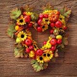 Autumn wreath. Over wooden background stock photos