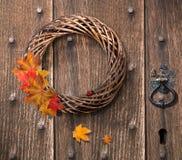 Autumn Wreath. Hanging on heavy Gothic wooden door stock image