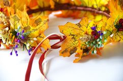 Autumn wreath of autumn leaves. Do it yourself on the instructions. A wreath of maple leaves for the autumn holidays. Crown made independently by the instruction royalty free stock photos