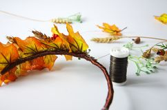 Autumn wreath of autumn leaves. Do it yourself on the instructions. A wreath of maple leaves for the autumn holidays. Crown made independently by the instruction royalty free stock image