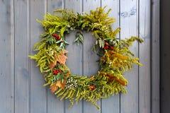 Autumn wreath decorating front door Royalty Free Stock Photo
