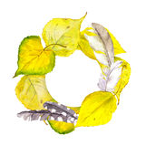 Autumn wreath frame with yellow autumn leaves and feathers Stock Photo