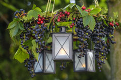 Autumn wreath hanging in the garden. Festive and party decoration stock image