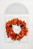 Autumn Wreath Hanging on White Door Stock Image