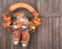 Autumn Wreath. Hanging on a wood background stock images