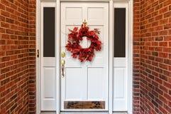 Autumn Wreath. Red Autumn wreath on front door walkway stock images