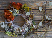 Autumn wreath on wooden background in the form of a circle Royalty Free Stock Photography