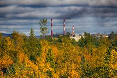 Autumn yellow forest and steel mill (metallurgic works). Stock Images