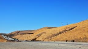 An autumn yellow grass and windmills Stock Photo