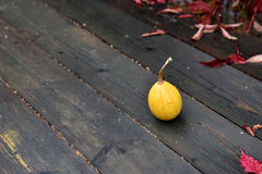 Autumn yellow pumpkin on a wooden table Stock Image