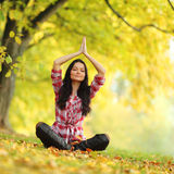 Autumn yoga woman Royalty Free Stock Image