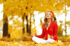 Autumn yoga woman Stock Photo