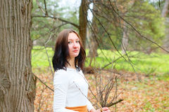 Autumn young girl outdoors with dry twigs in her hand Stock Photo