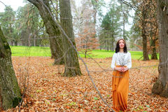 Autumn young woman outdoors with dry twigs in her hand Stock Images