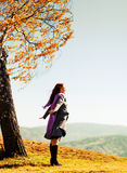 Young woman standing on an autumn hill Royalty Free Stock Images