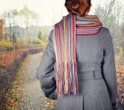 Young woman walking in the fall season Royalty Free Stock Photos
