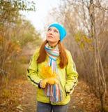 Young woman walking in the fall season Stock Photo
