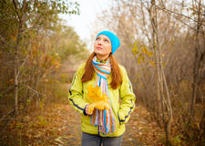 Young woman walking in the fall season Stock Photo