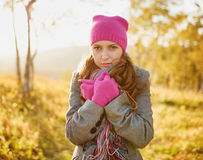 Young woman walking in the fall season Stock Images