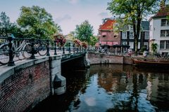 Autumnal Amsterdam canal scene with bicycles and bridge.  royalty free stock image