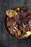 Autumnal composition with colored dry leaves on vintage tray  Royalty Free Stock Image