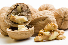 Autumnal composition with nuts and pulp of nut. Composition with nuts, one of them opened, and pulp of nut Stock Image