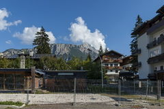 Autumnal corso Italia, the residential district in the town Cortina d`Ampezzo with mountain, Dolomite, Alps, Veneto. Italy, Europe Royalty Free Stock Photography