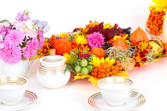Autumnal decorated coffee table. Coffee table, decorated with with autumn fruits and autumn flowers Royalty Free Stock Photo