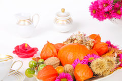 Autumnal decorated coffee table. Coffee table, decorated with pumpkins and other autumn fruits Stock Images