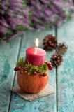 Autumnal decoration with candleholder on turquoise wood. Autumnal decoration with candleholder on wood royalty free stock photos