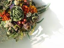 Autumnal dried bouquet. Soft color autumnal floral arrangement stock photography