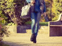 Part body of fashionable woman. Autumnal fashion of women. Fashionable girl wearing trendy clothes walking in park. Part body of model outdoors Stock Image