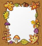 Autumnal frame series 2. Vector frame with autumnal nature symbols on wooden background, with space for your text vector illustration