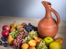 Autumnal fruit still life with Georgian jug on rustic wooden tab. Le background Royalty Free Stock Photography