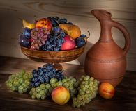 Autumnal fruit still life with Georgian jug on rustic wooden tab Stock Images