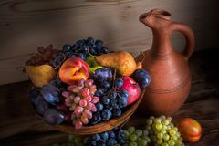 Autumnal fruit still life with Georgian jug on rustic wooden tab Stock Photography