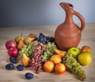 Autumnal fruit still life with Georgian jug on rustic wooden tab. Le background Royalty Free Stock Photos