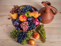 Autumnal fruit still life with Georgian jug on rustic wooden tab. Le background Stock Image