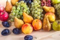 Autumnal fruit still life on rustic wooden table background.  Royalty Free Stock Photography