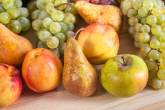 Autumnal fruit still life on rustic wooden table background Royalty Free Stock Photos