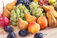 Autumnal fruit still life on rustic wooden table background.  Royalty Free Stock Image