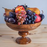 Autumnal fruit still life on rustic wooden table background.  Stock Photo