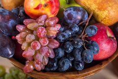 Autumnal fruit still life on rustic wooden table background.  Royalty Free Stock Photos