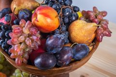 Autumnal fruit still life on rustic wooden table background Royalty Free Stock Image