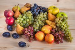 Autumnal fruit still life on rustic wooden table background Stock Images