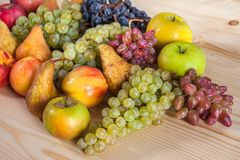 Autumnal fruit still life on rustic wooden table background.  Royalty Free Stock Images