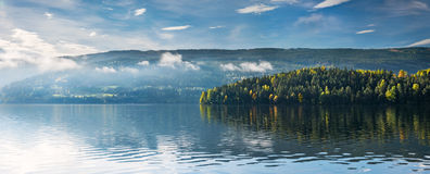 Autumnal glow. Morning mist above Strondafjord near Fagernes in autumn. Fagernes, Oppland, Norway stock photography