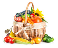 Autumnal harvest vegetables and fruits in basket Stock Images