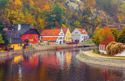 Autumnal landscape with coloured house over river Royalty Free Stock Images